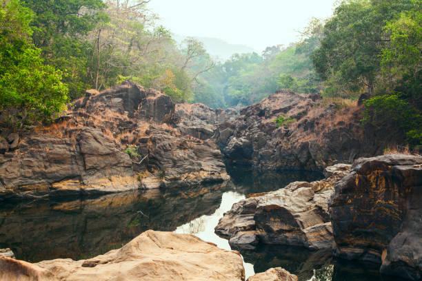 A calm river among the rough cliffs stock photo