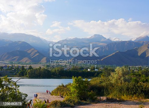 istock Calm scene at Lake Issyk Kul in Kyrgyzstan 1256480573