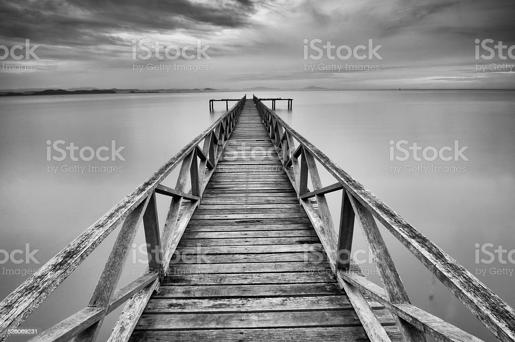 Calm scene of abandoned jetty at Teluk Tempoyak stock photo