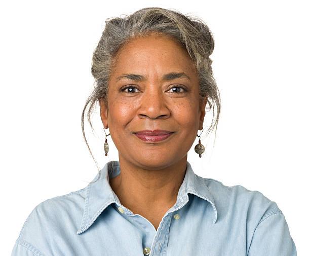 calm smiling mature woman portrait - 50 59 jaar stockfoto's en -beelden