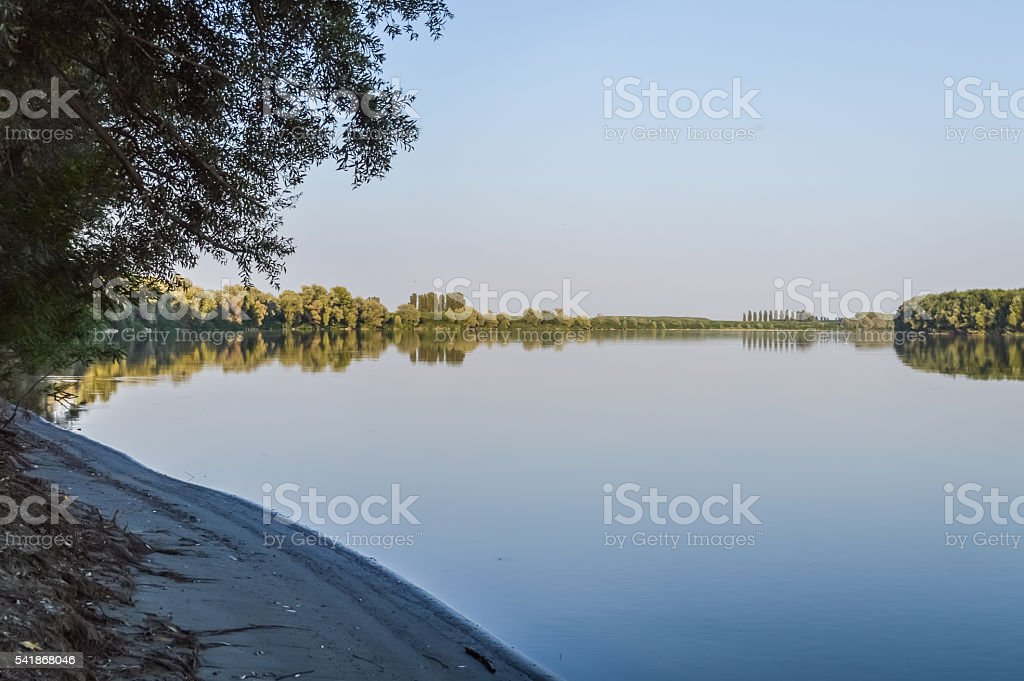 calm water and river shore stock photo