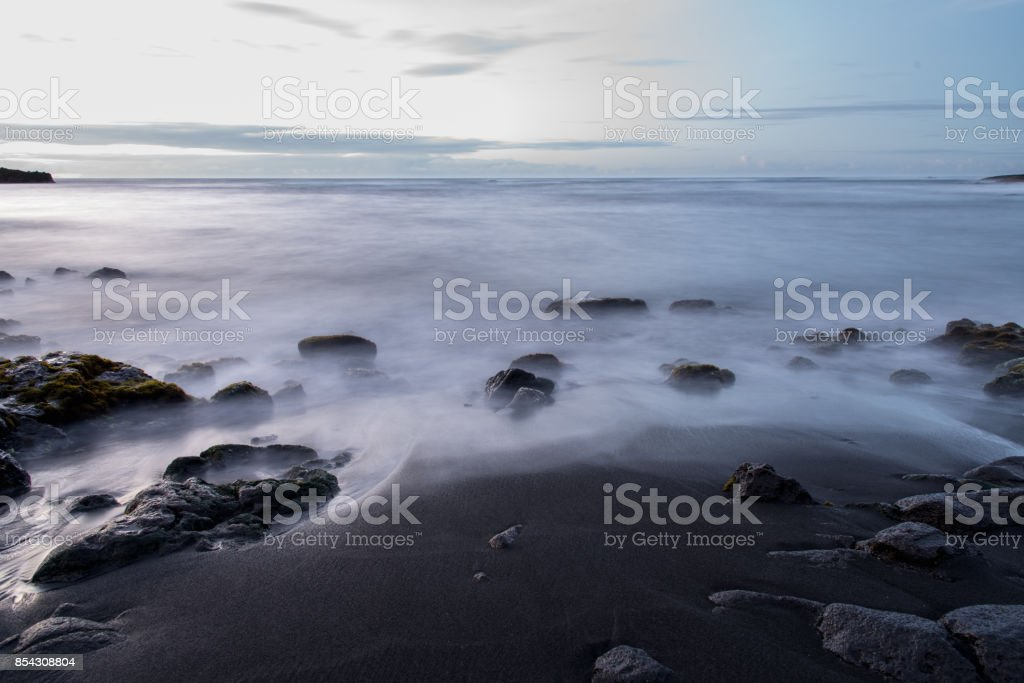 Calm Water on a Black Sand Beach stock photo