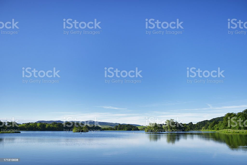 Calm water on a Scottish loch in early morning stock photo