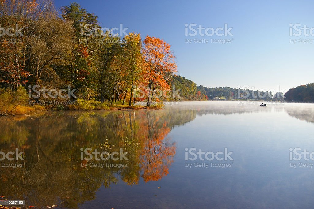 Calm waters of Sweet Arrow Lake in autumn royalty-free stock photo