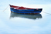Small fishing boat in the ocean with nobody inside of it