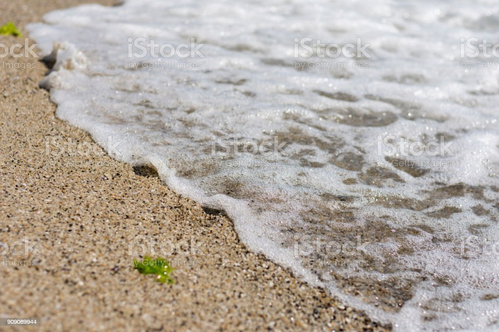 Calm wave of sea on the beach. Close up view. Selective focus. Copy,...