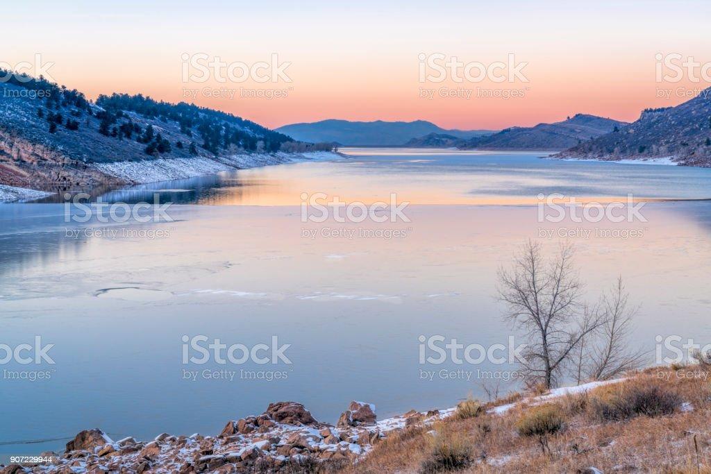 calm winter dusk over mountain lake stock photo
