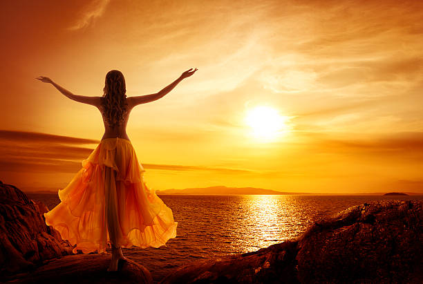 Calm Woman Meditating, Sunset Relax, Open Arms Pose Calm Woman Meditating on Sunset Beach, Girl Relax in Open Arms Pose reincarnation stock pictures, royalty-free photos & images