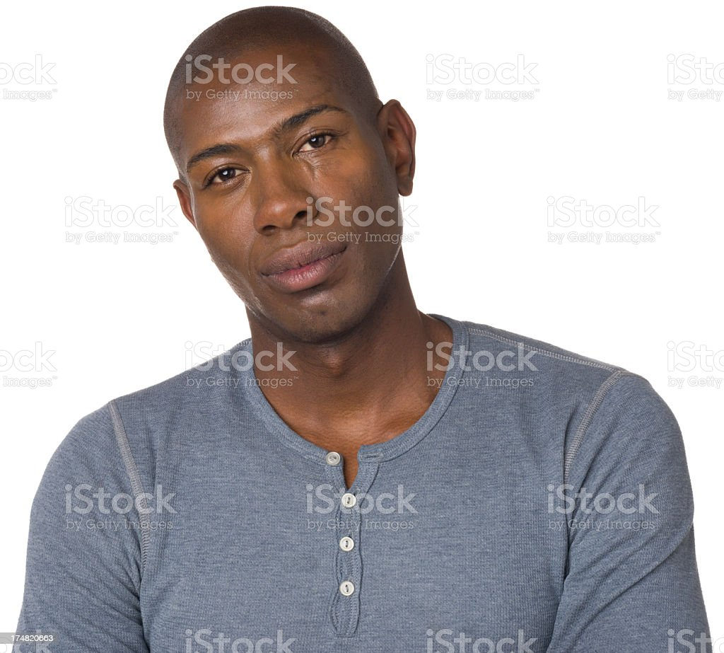 Calm Young Man Looking At Camera With Blank Expression royalty-free stock photo