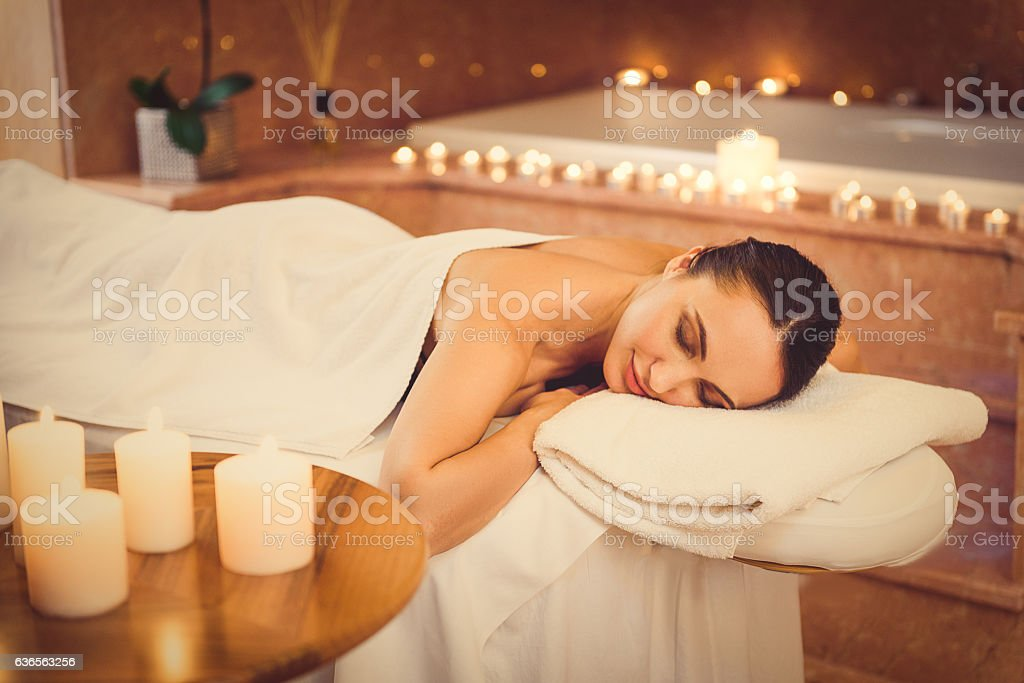 Calm young woman lying at beauty salon stock photo