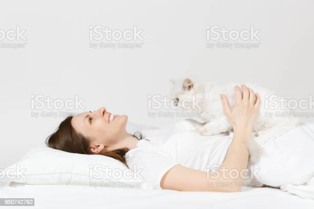 Calm young woman lying in bed with white cute persian silver cat picture id950742762?b=1&k=6&m=950742762&s=612x612&h=7yf3jypi7bivvu98nxhbt2h0l34dtabj2uozdkxvexo=