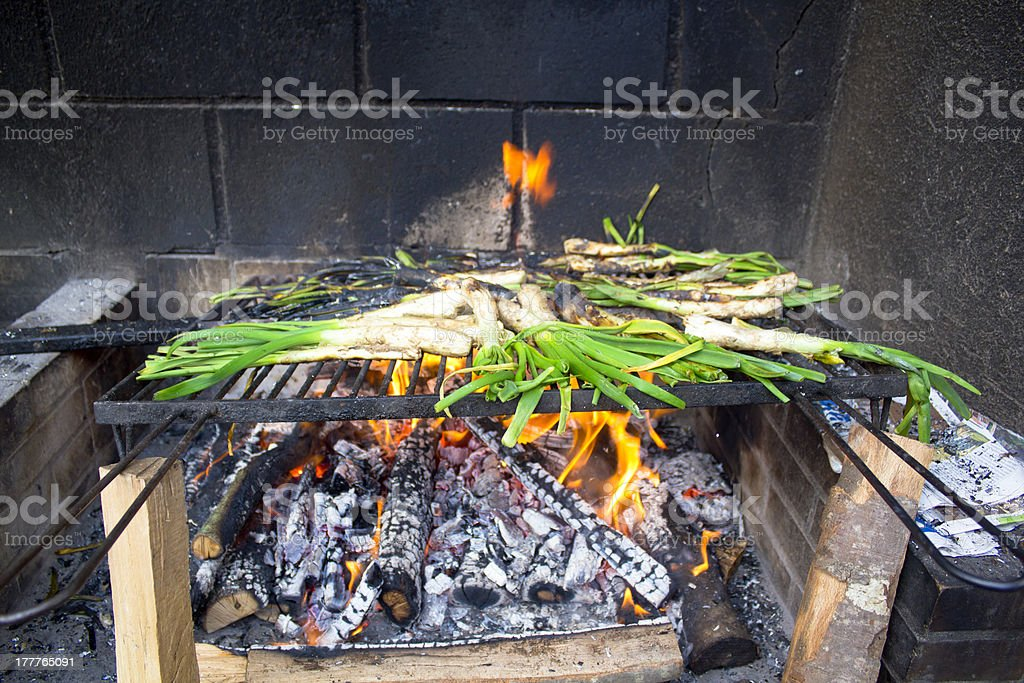 Calçots in a barbeque royalty-free stock photo
