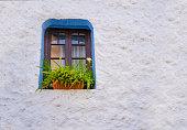 Calpe Calp mediterranean flowers window detail in old town at Alicante of Spain
