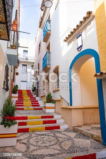 Calpe Calp Spanish flag in curb at Puchalt street at Alicante of Spain