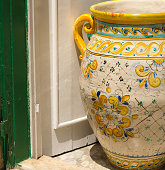 Caltagirone, Sicily: Large antique ceramic pot outside a shop in central Caltagirone, a city famous for the production of tiles and majolica and part of the Val di Noto UNESCO World Heritage Site.