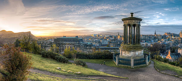 Calton Hill at sunrise Calton HIll pillars at sunrise. Edinburgh, Scotland edinburgh scotland stock pictures, royalty-free photos & images