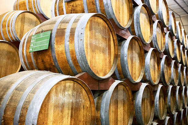 Calvados barrels in storage at the plant in Normandy, France photo made at a factory for the production of Calvados in Normandy, France calvados stock pictures, royalty-free photos & images