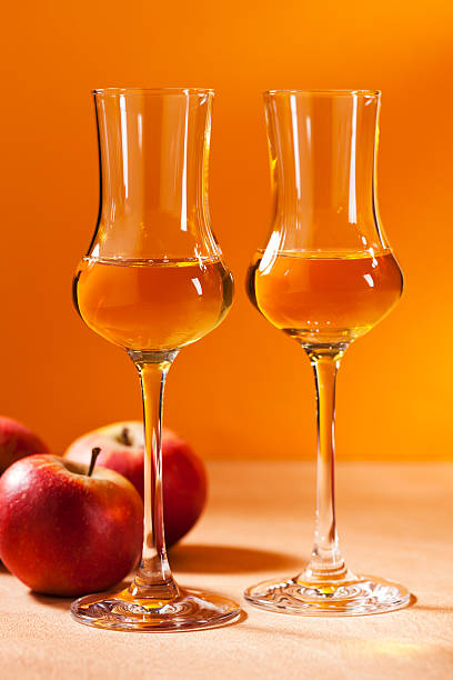 Calvados Brandy Two glasses of Calvados Brandy and red apples calvados stock pictures, royalty-free photos & images