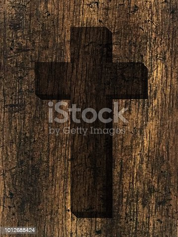 A dark image of the Christian religious cross of Christ on a rustic brown wood grain background.