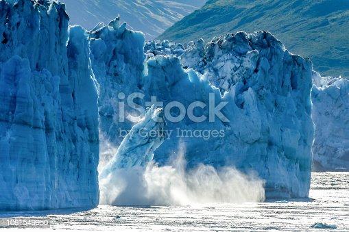 istock Calving Glacier Alaska - Hubbard Glacier - a huge iceberg calves into Disenchantment Bay - St. Elias Alaska. Taken from an Alaska cruise ship - near Yukon, Canada 1061549950