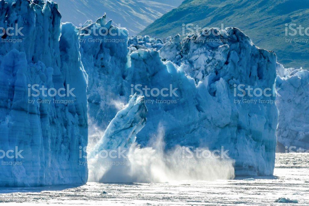 Calving Glacier Alaska - Hubbard Glacier - a huge iceberg calves into Disenchantment Bay - St. Elias Alaska. Taken from an Alaska cruise ship - near Yukon, Canada stock photo
