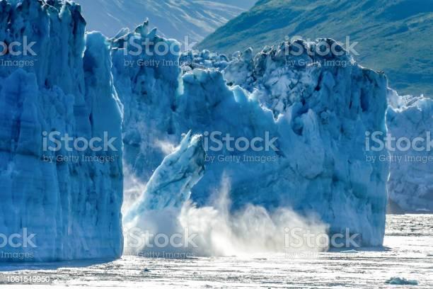 Photo of Calving Glacier Alaska - Hubbard Glacier - a huge iceberg calves into Disenchantment Bay - St. Elias Alaska. Taken from an Alaska cruise ship - near Yukon, Canada