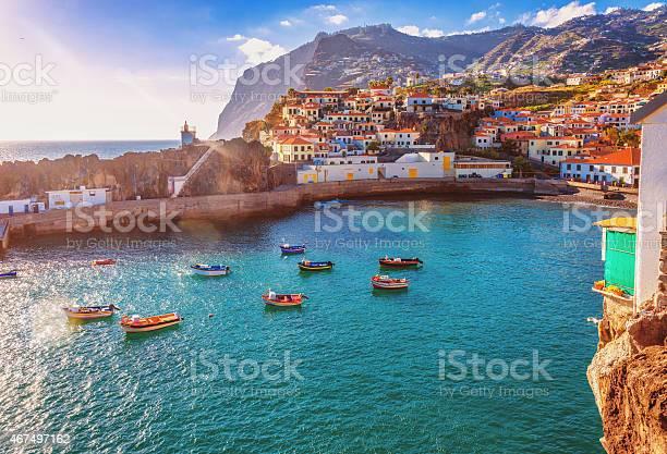 The beautiful fishing village of Camara de Lobos on the portugese Island of Madeira in warm evening sunshine light.