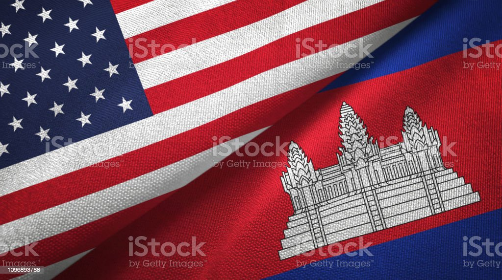 Cambodia and United States two flags together textile cloth, fabric texture Cambodia and United States flags together textile cloth, fabric texture Agreement Stock Photo