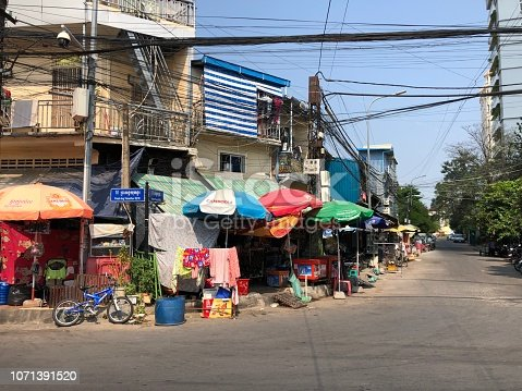 Visiting side streets in Phnom Penh, Cambodia, admiring local buildings and shops demonstrating simple life in Asia