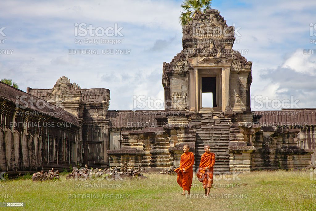 Cambodian Buddist Monks at Angkor Wat Ancient Temple Ruins royalty-free stock photo
