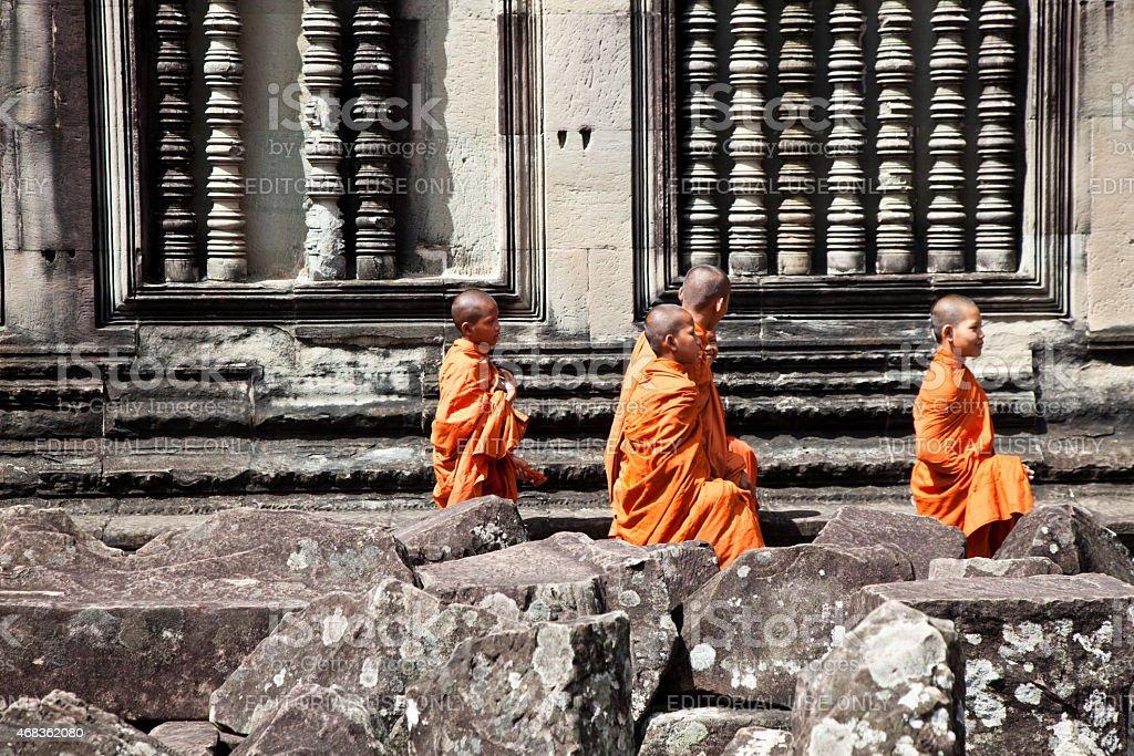 Cambodian Buddist Monks at Angkor Wat Ancient Temple Ruins royalty-free stock photo