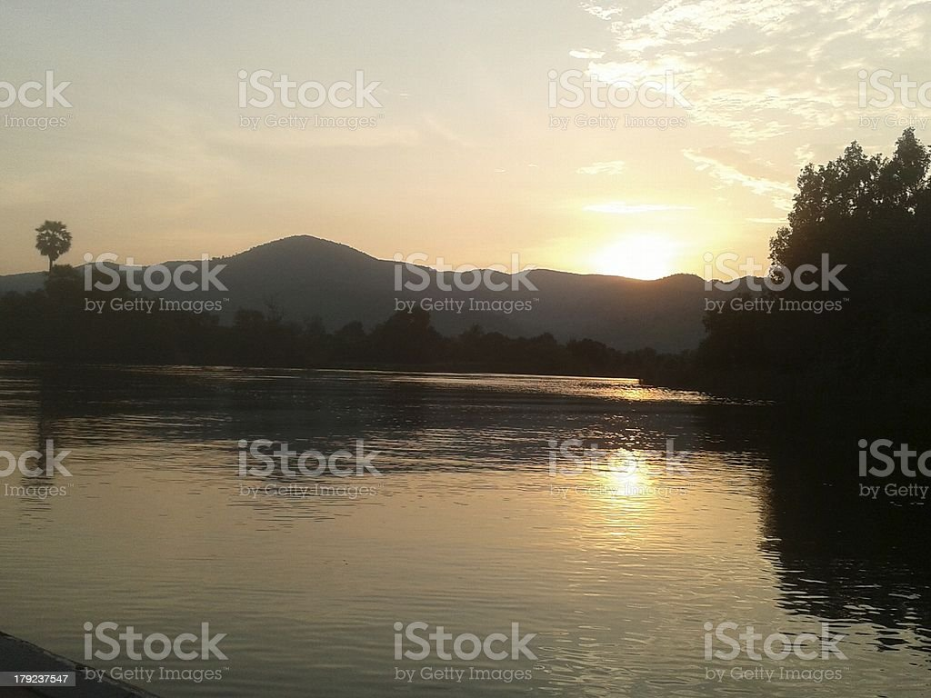 Cambodian river sunset stock photo