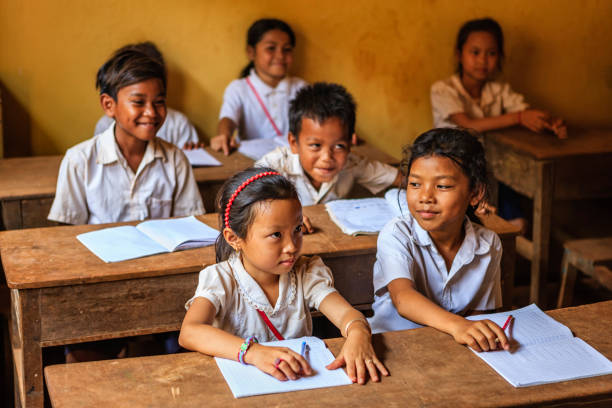 Cambodian school children during class, Tonle Sap, Cambodia Cambodian children during language class in small school near Tonle Sap, Cambodia. southeast asia stock pictures, royalty-free photos & images
