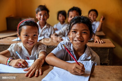 Cambodian children during language class in small school near Tonle Sap, Cambodia.
