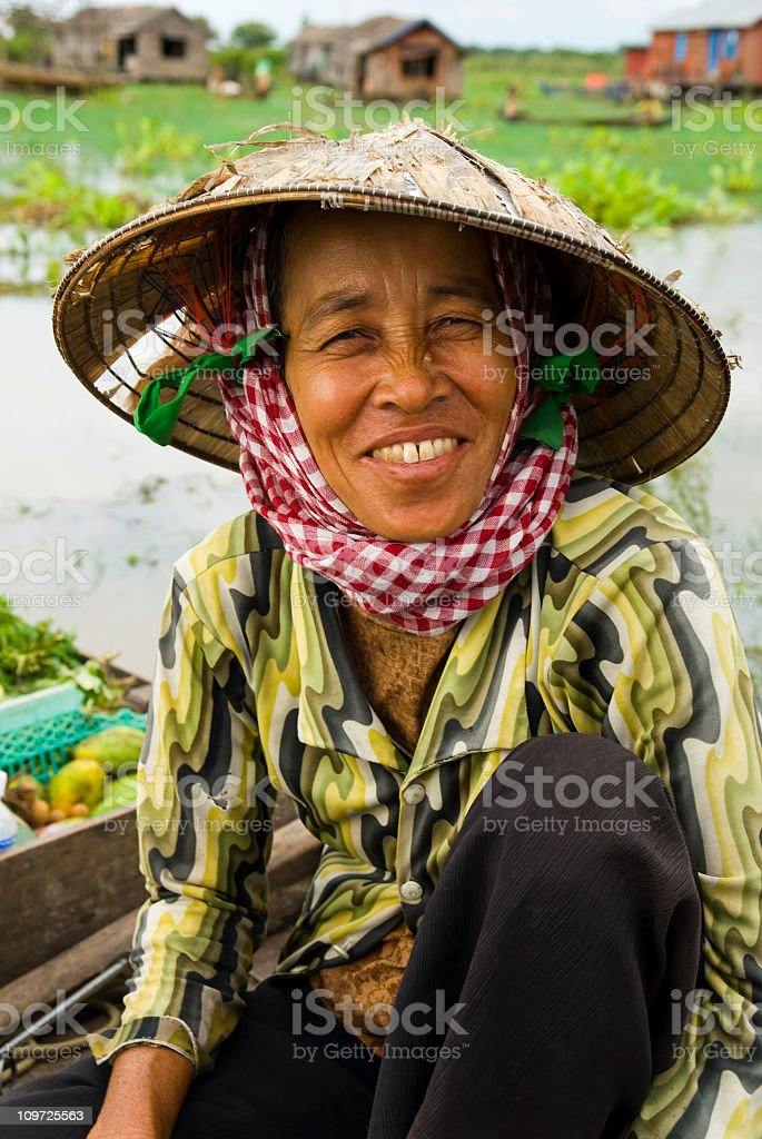Cambodian Woman in Boat royalty-free stock photo