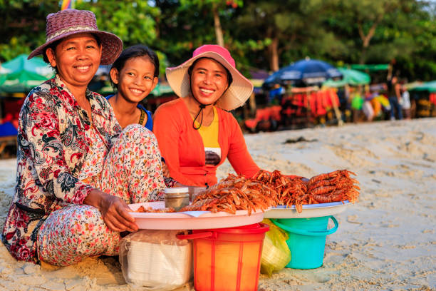 Cambodian women selling fresh lobsters on the beach, Sihanoukville, Cambodia stock photo