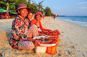 Cambodian women selling fresh lobsters on the beach, Sihanoukville, Cambodia