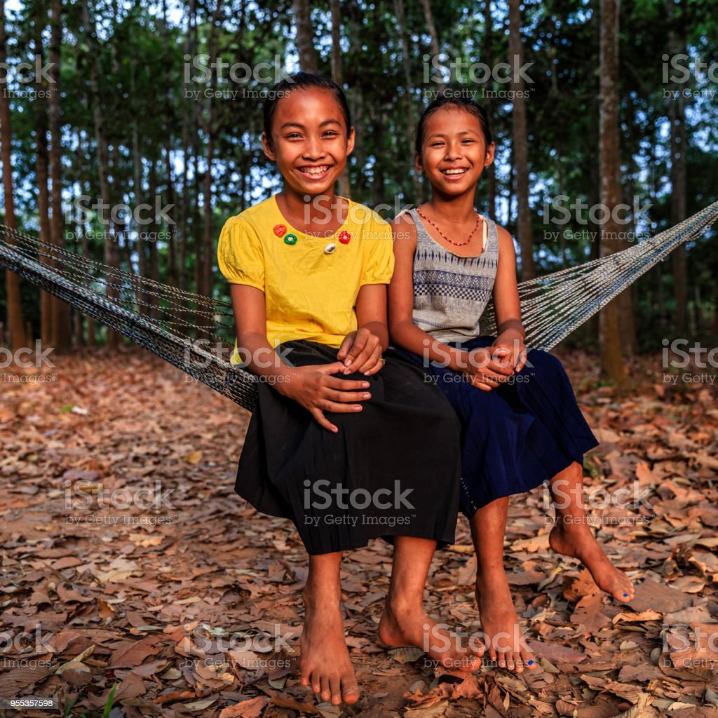 Cambodian young girls sitting on hammock near Siem Reap, Cambodia stock photo