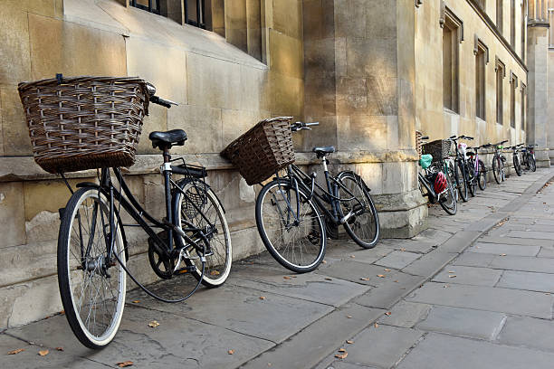 cambridge university bicycles - cambridge university stock photos and pictures