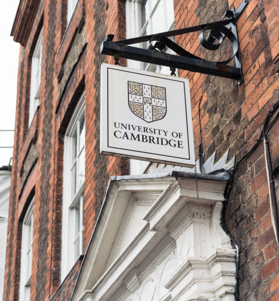cambridge university sign above building entrance - cambridge university stock photos and pictures