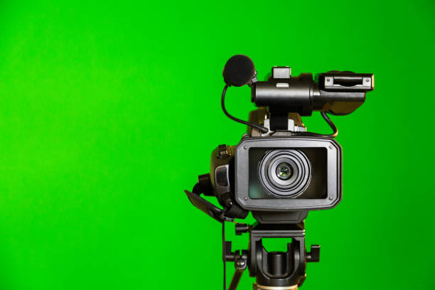 Camcorder on a green background. Filming in the interior. The chroma key