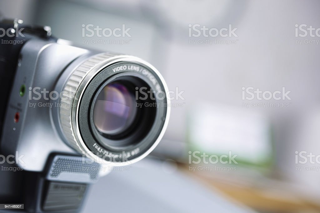 Camcorder pointed to the bottom right of the screen royalty-free stock photo