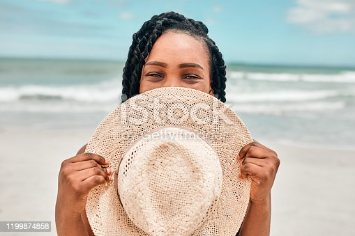 Portrait of an attractive young woman spending some time at the beach