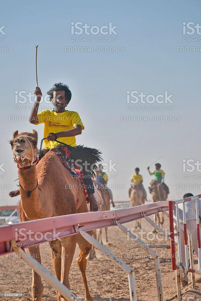 Camel racer at the Al Dahfra Camel Festival, UAE stock photo