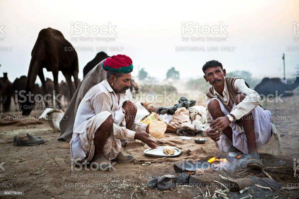 camel traders in pushkar stock photo
