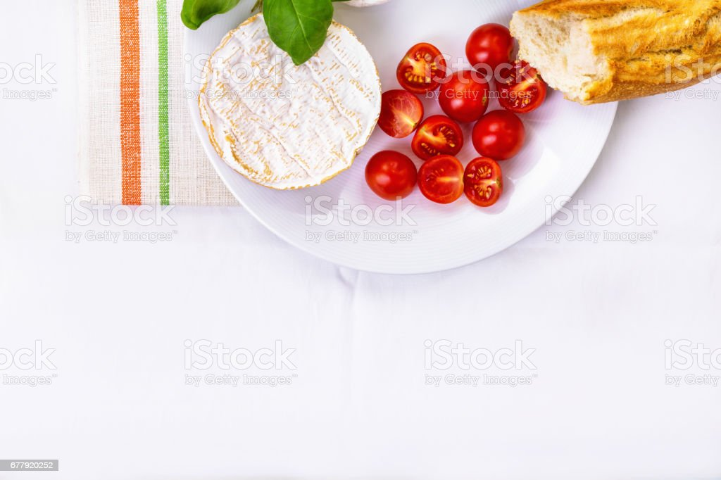 camembert, bread and tomatoes on a plate royalty-free stock photo