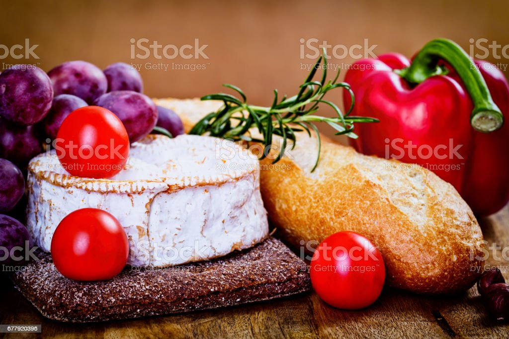 camembert, bread and vegetables royalty-free stock photo