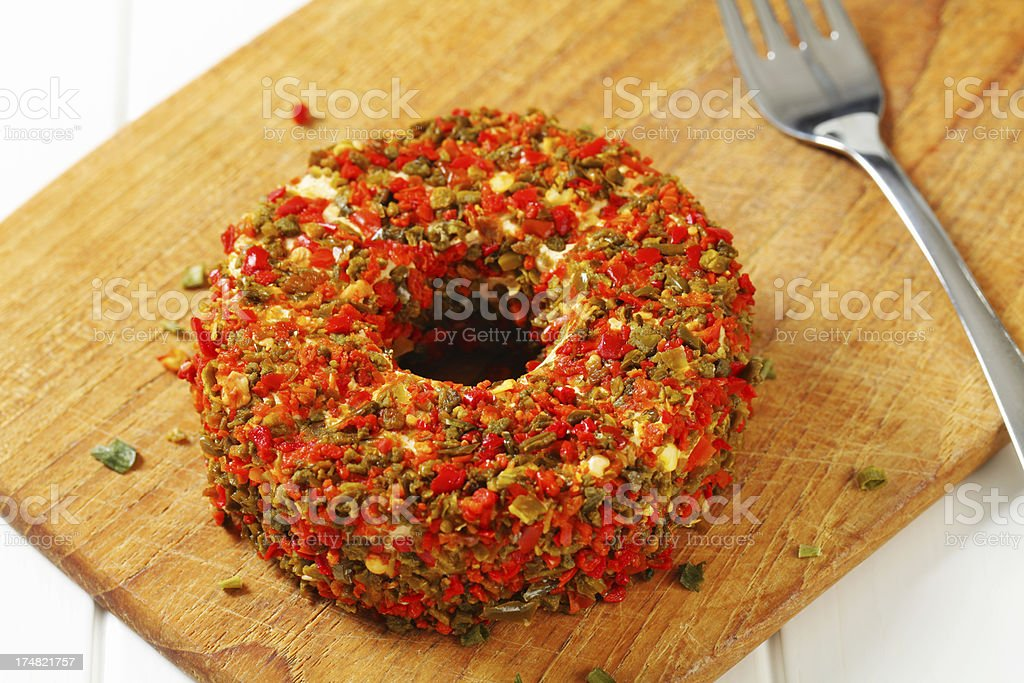 Camembert cheese coated in paprika spice royalty-free stock photo