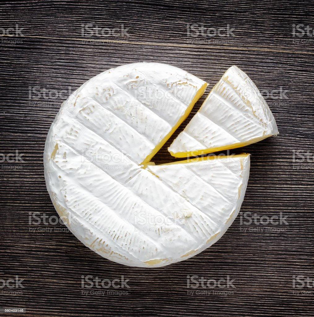 Camembert cheese on a wooden board stock photo