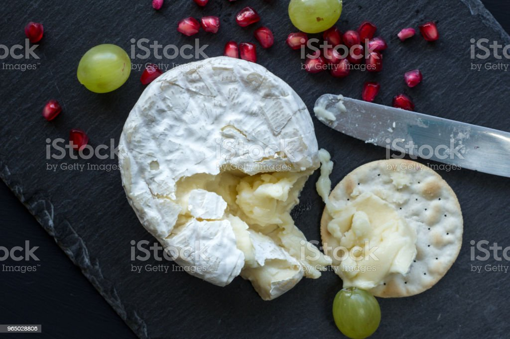 Camembert cheese on slate cheese board - top view photo royalty-free stock photo